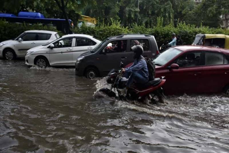 Delhi: Early morning rain leads to snarls, water logging, wall collapses